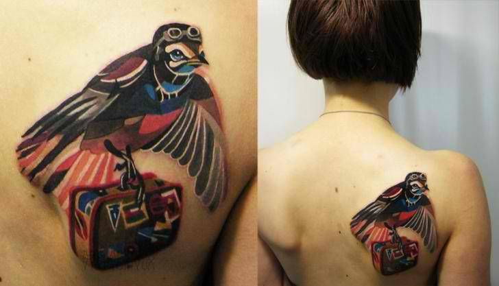 traveling bird tattoo