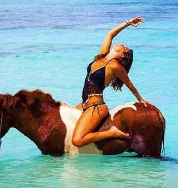 yoga on a horse in tropical waters