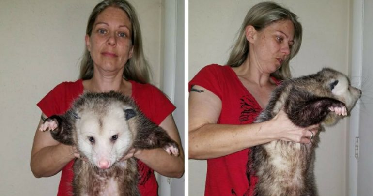 woman and opossum