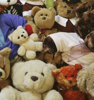 teddy bears laying in a pile in a child's room
